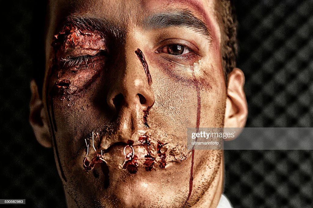 Stage makeup beaten face  HDR Portrait  Young man   Ultimate fighter : Stock Photo