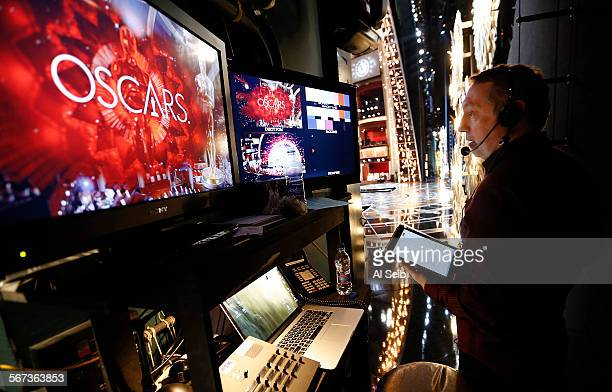 Stage Manager Gary Natoli right watches monitors just off stage during rehearsals in the Dolby Theatre February 18 2015 for the 87th Academy Awards...