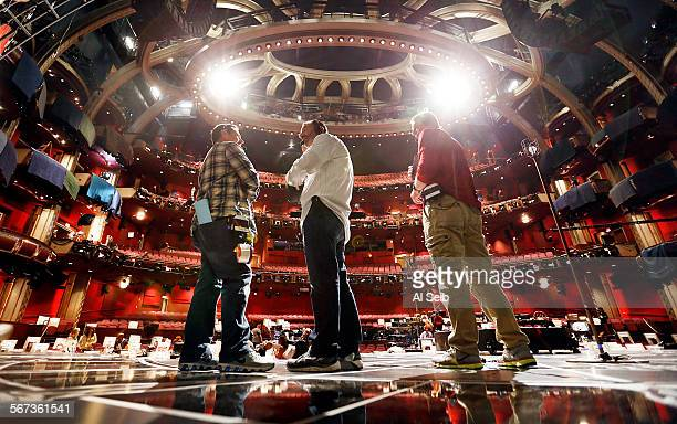 Stage Managers John Esposito Ron Paul and Dave Cove left to right confer on center stage during rehearsals in the Dolby Theatre February 18 2015 for...