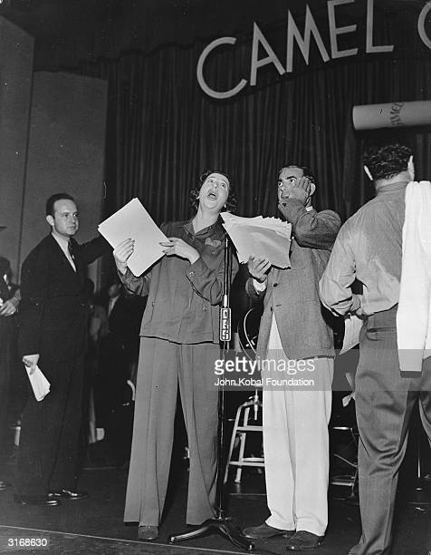 Stage radio vaudeville and burlesque actress Fanny Brice with Jewish comedian Eddie Cantor recording a piece for Cantor's radio show