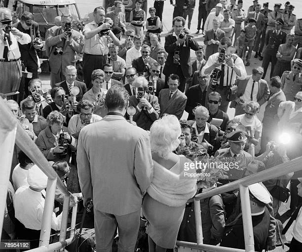 Stage Screen Berlin Film Festival Germany American film amd movie actress Jane Mansfield with her husband Mickey Hargitay are faced by press...