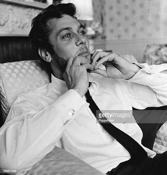 Stage Screen Dorcester Hotel London England American film and movie actor Tony Curtis relaxing in his room