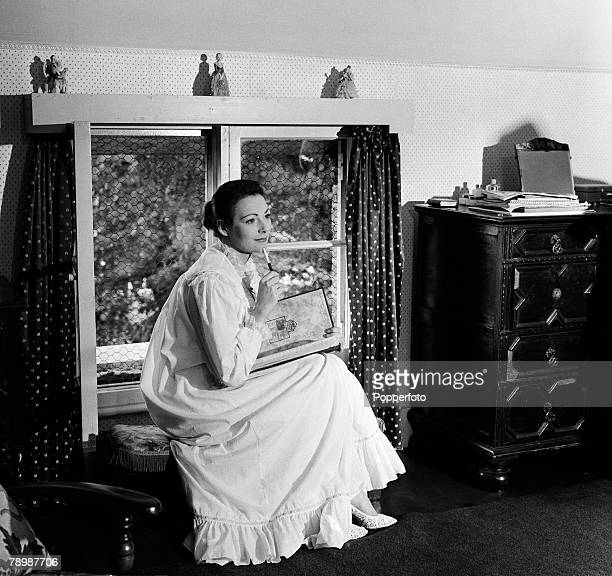 Stage Screen England 1957 British film and movie actress Ann Sears sitting on a small stool
