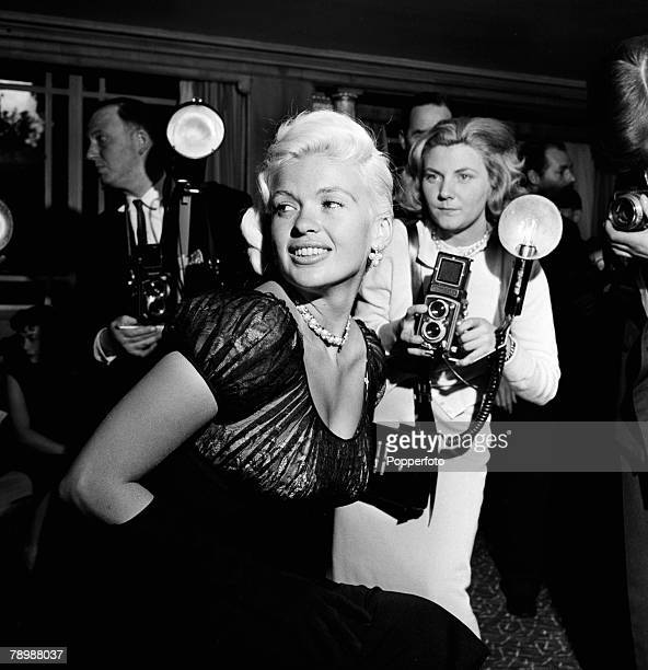 Stage Screen London England American film and movie actress Jane Mansfield surrounded by photographers reporters as she attends a press conference at...
