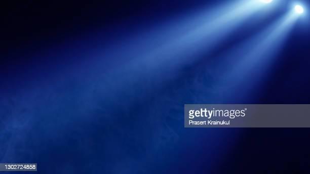 stage spotlight with laser rays. concert lighting background - riflettore lenticolare foto e immagini stock