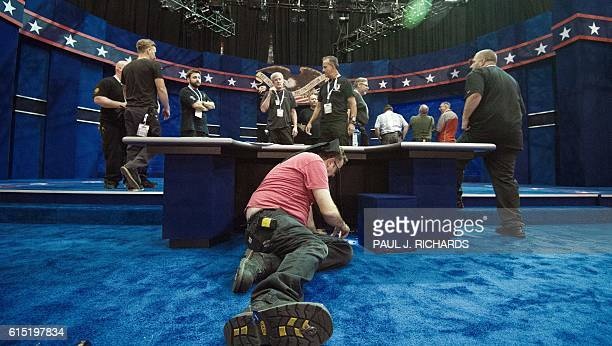 Stage technicians make final touches to the stage and moderator desk October 17, 2016 at the Thomas & Mack Center on the campus of the University of...