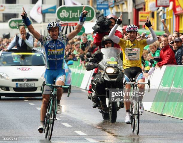 Stage Three winner Lars Petter Nordhaug of Norway and Joker Bianchi team and overall race winner Russell Downing of Great Britain and CandiTV -...