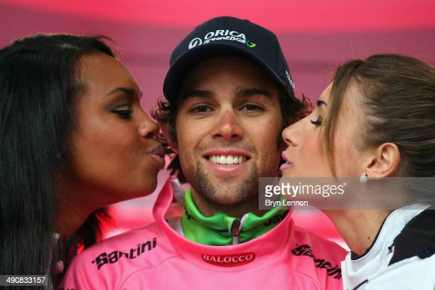 Stage winner and Maglia Rosa wearer Michael Matthews of Australia and team OricaGreenEDGE celebrates on the podium after the sixth stage of the 2014...