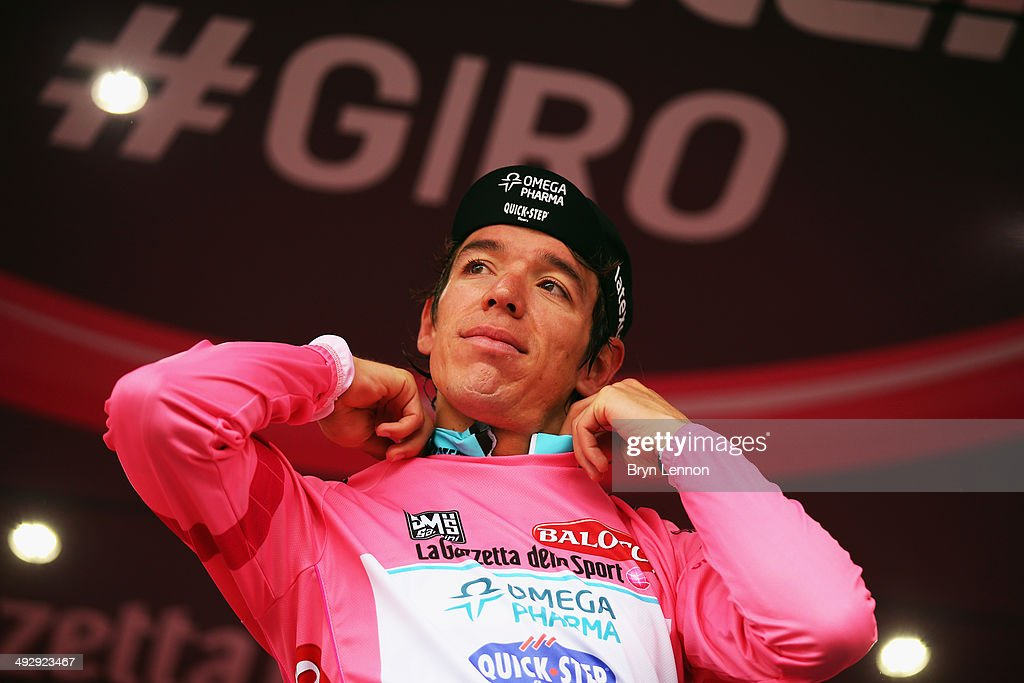 Stage winner and new race leader and wearer of the Maglia Rosa Rigoberto Uran of Colombia and Omega Pharma-Quickstep celebrates on the podium after winning the twelfth stage of the 2014 Giro d'Italia, a 42km Individual Time Trial stage between Barbarasco and Barolo on May 22, 2014 in Barbarasco, Italy.