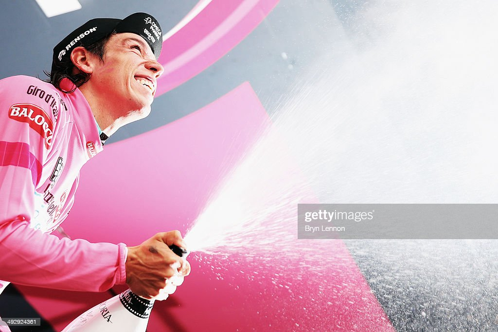 Stage winner and new race leader and wearer of the Maglia Rosa Rigoberto Uran of Colombia and Omega Pharma-Quickstep celebrates and sprays prosecco on the podium after winning the twelfth stage of the 2014 Giro d'Italia, a 42km Individual Time Trial stage between Barbarasco and Barolo on May 22, 2014 in Barbarasco, Italy.