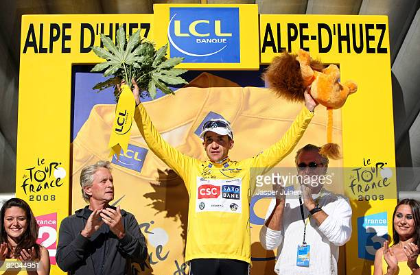 L'ALPED'HUEZ FRANCE JULY 23 Stage winner and new race leader Carlos Sastre of Spain and team CSC Saxo Bank celebrates on the podium in the yellow...