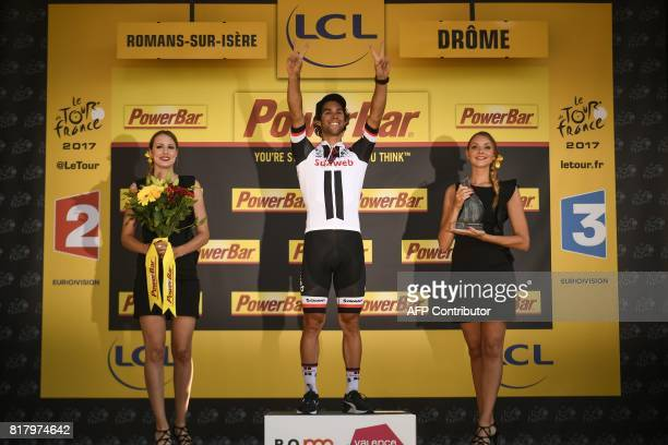 Stage winner Australia's Michael Matthews celebrates on the podium after winning the 165 km sixteenth stage of the 104th edition of the Tour de...