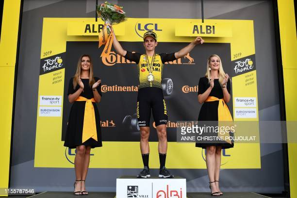 Stage winner Belgium's Wout van Aert celebrates his victory on the podium of the tenth stage of the 106th edition of the Tour de France cycling race...