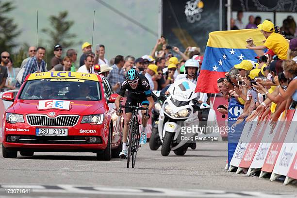 Stage winner Chris Froome of Great Britain and Team Sky Procycling is cheered on by the crowd as he approaches the finish line during stage eight of...