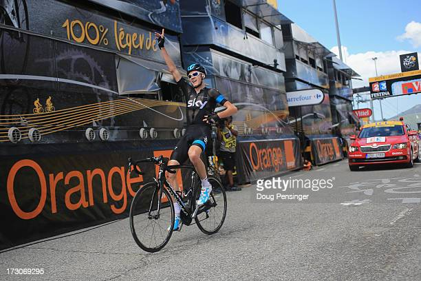 Stage winner Chris Froome of Great Britain and Team Sky Procycling celebrates as he crosses the line during stage eight of the 2013 Tour de France a...