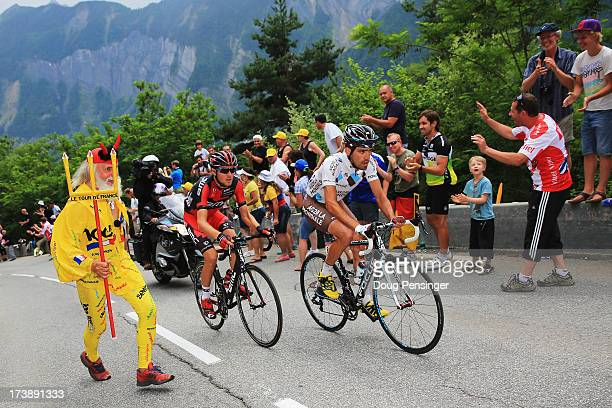 Stage winner Christophe Riblon of France and Team AG2R La Mondiale and Tejay van Garderen of the United States and BMC Racing Team pass cycling fan...