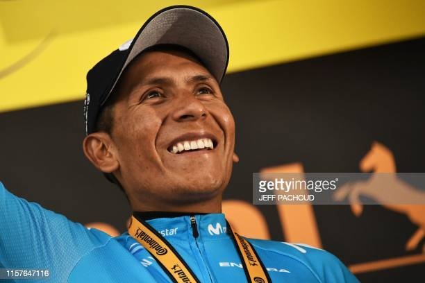 Stage winner Colombia's Nairo Quintana celebrates his victory on the podium of the eighteenth stage of the 106th edition of the Tour de France...
