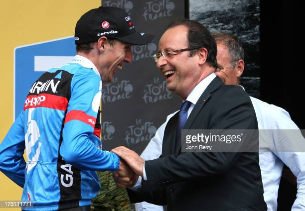 Stage winner Daniel Martin of Ireland and Team Garmin-Sharp congratulated by French President Francois Hollande after Stage Nine of the Tour de...