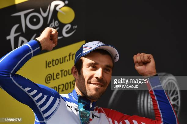 Stage winner France's Thibaut Pinot celebrates his victory on the podium of the fourteenth stage of the 106th edition of the Tour de France cycling...