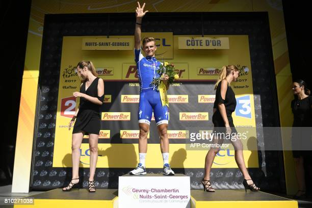 Stage winner Germany's Marcel Kittel celebrates on the podium after winning the 2135 km seventh stage of the 104th edition of the Tour de France...