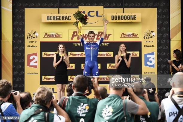 Stage winner Germany's Marcel Kittel celebrates on the podium after winning the 178 km tenth stage of the 104th edition of the Tour de France cycling...