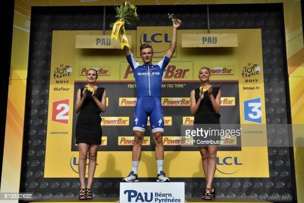 Stage winner Germany's Marcel Kittel celebrates on the podium after winning the 2035 km eleventh stage of the 104th edition of the Tour de France...