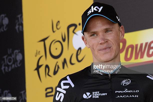 Stage winner Great Britain's Christopher Froome celebrates on the podium after winning the 167 km tenth stage of the 102nd edition of the Tour de...