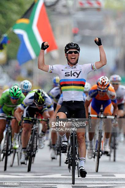 Stage winner Great Britain's Mark Cavendish celebrates on the finish line ahead of stage secondplaced Australia's Matthew Harley Goss third placed...