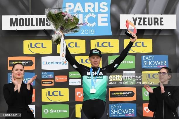 Stage winner Ireland's Sam Bennett celebrates on the podium after winning the 200km 3rd stage of the 77th ParisNice cycling race stage between Cepoy...