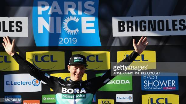 Stage winner Ireland's Sam Bennett celebrates on the podium after winning the 1765km 6th stage of the 77th ParisNice cycling race stage between...