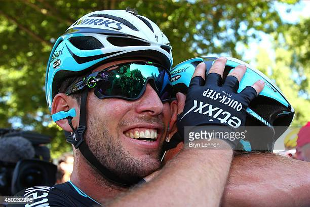 Stage winner Mark Cavendish of Great Britain and EtixxQuick Step is congrtulated by teammate Mark Renshaw of Australia and EtixxQuick Step following...