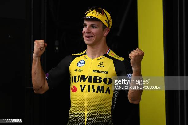Stage winner Netherlands' Dylan Groenewegen celebrates his victory on the podium of the seventh stage of the 106th edition of the Tour de France...