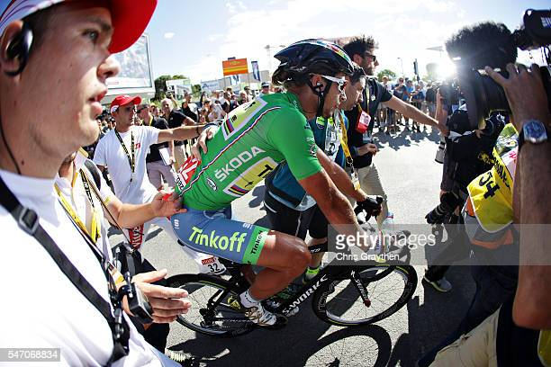 Stage winner Peter Sagan of Slovakia riding for Tinkoff gets pushed through the crowds at the end of stage eleven of the 2016 Le Tour de France, a...