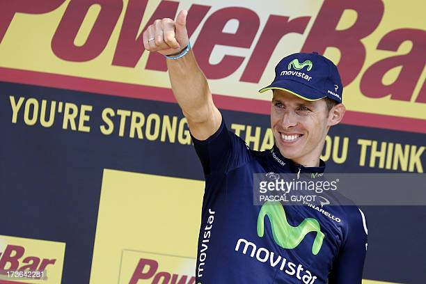 Stage winner Portugal's Rui Alberto Costa celebrates on the podium after winning the 168 km sixteenth stage of the 100th edition of the Tour de...