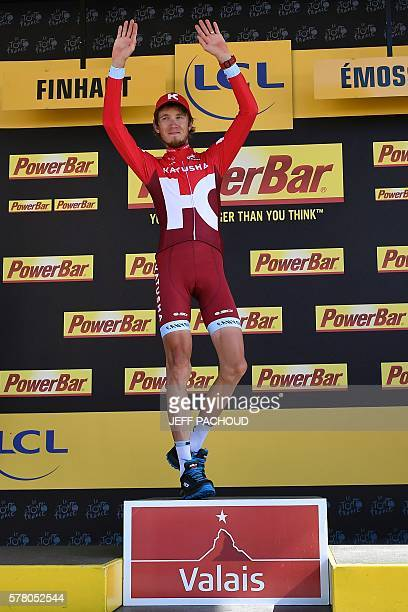 Stage winner Russia's Ilnur Zakarin celebrates on the podium after winning the 184,5 km seventeenth stage of the 103rd edition of the Tour de France...