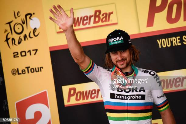 Stage winner Slovakia's Peter Sagan celebrates on the podium after winning at the end of the 2125 km third stage of the 104th edition of the Tour de...