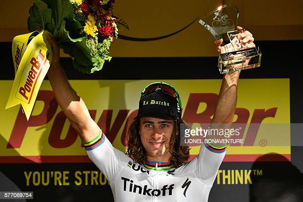 Stage winner Slovakia's Peter Sagan celebrates on the podium after winning the 209 km sixteenth stage of the 103rd edition of the Tour de France...