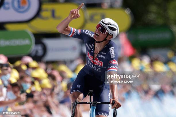 Stage winner Team Alpecin Fenix' Mathieu van der Poel of Netherlands celebrates as he crosses the finish line at the end of the 2nd stage of the...