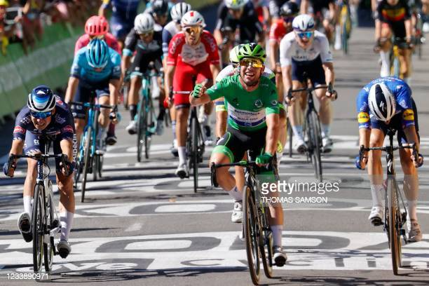 Stage winner Team Deceuninck Quickstep's Mark Cavendish of Great Britain wearing the best sprinter's green jersey crosses the finish line at the end...