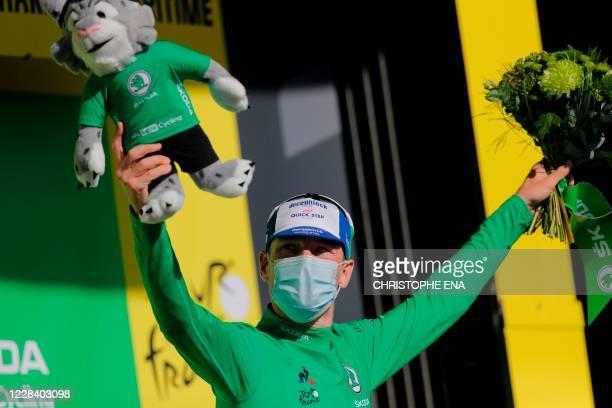 Stage winner Team Deceuninck rider Ireland's Sam Bennett celebrates his green jersey of best sprinter on the podium after winning the 10th stage of...