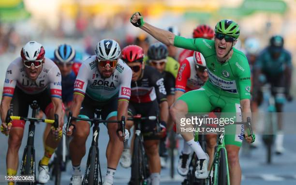 Stage winner Team Deceuninck rider Ireland's Sam Bennett wearing the best sprinter's green jersey celebrates as he crosses the finish line during the...