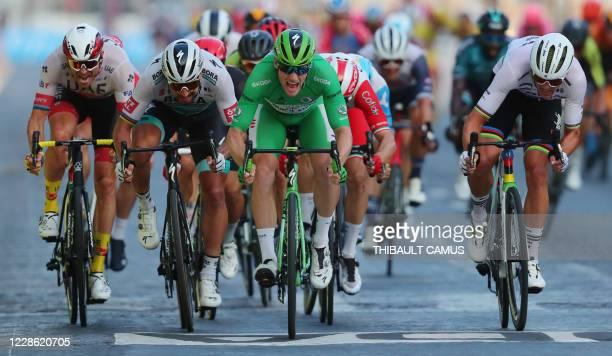 Stage winner Team Deceuninck rider Ireland's Sam Bennett wearing the best sprinter's green jersey celebrates as he crosses the finish line during the...