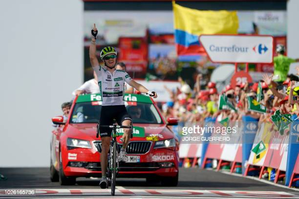 Stage winner Team Dimension Data's US cyclist Benjamin King celebrates as he crosses the finish line of the ninth stage of the 73rd edition of La...