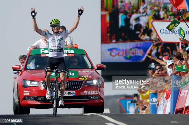 Stage winner Team Dimension Data's US cyclist Benjamin King celebrates winning the ninth stage of the 73rd edition of La Vuelta Tour of Spain cycling...