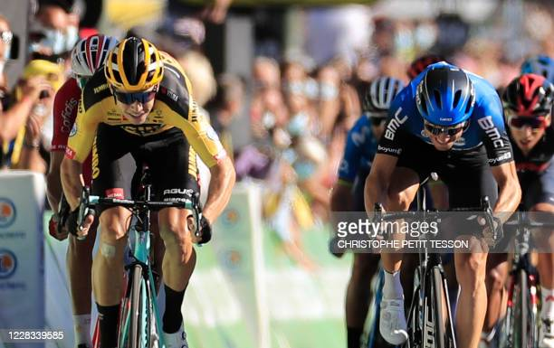 Stage winner Team Jumbo rider Belgium's Wout van Aert and Team NTT Pro Cycling rider Norway's Edvald Boasson Hagen sprint to crosses the finish line...