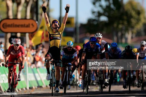 Stage winner Team Jumbo rider Belgium's Wout van Aert celebrates as he crosses the finish line at the end of the 7th stage of the 107th edition of...