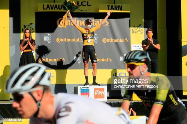 Stage winner Team Jumbo rider Belgium's Wout van Aert celebrates on the podium after winning the 7th stage of the 107th edition of the Tour de France...