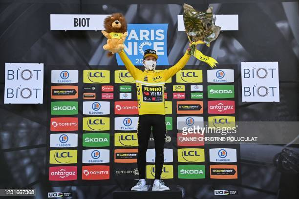 Stage winner Team Jumbo rider Slovenia's Primoz Roglic celebrates his overall leader yellow jersey on the podium at the end of the 6th stage of the...