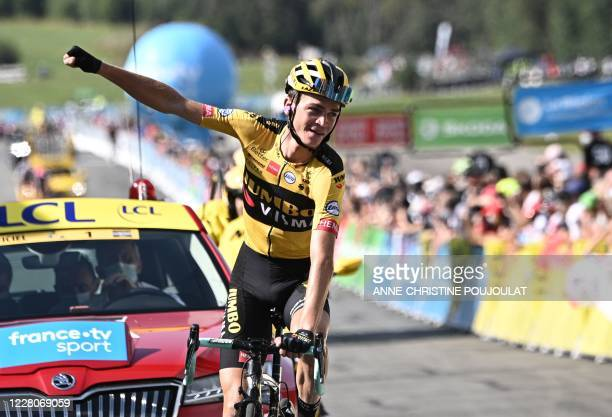 Stage winner Team Jumbo rider US Sepp Kuss celebrates as he crosses the finish line of the fifth stage of the 72nd edition of the Criterium du...