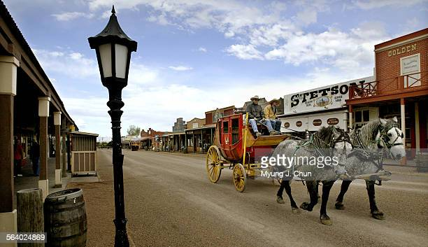A stagecoach takes visitors on a tour around downtown Tombstone Ariz Photo shot on